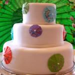 Painted sugar umbrella wedding cake