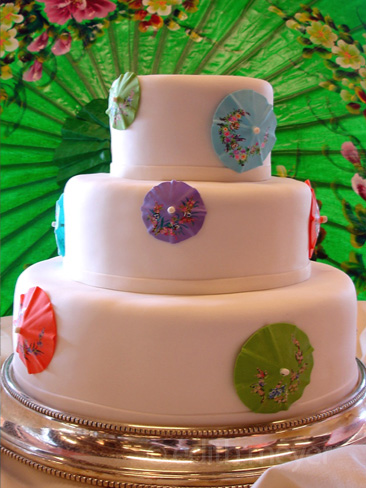 Painted sugar umbrella wedding cake